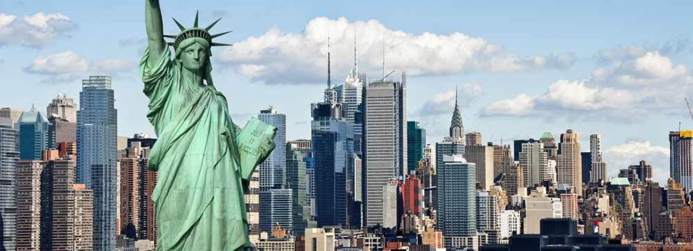 An ariel shot of New York City and the Statue of Liberty