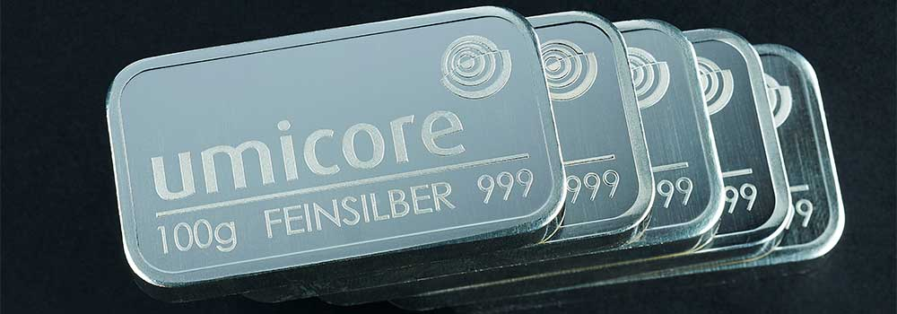 A stack of 100g Umicore Silver Bullion Investment Bars
