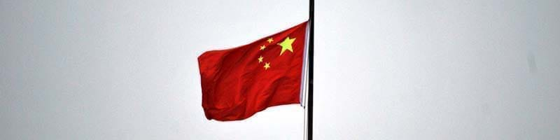 A Chinese flag blowing in the wind