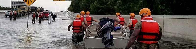 Rescue team wading through Texas Flood