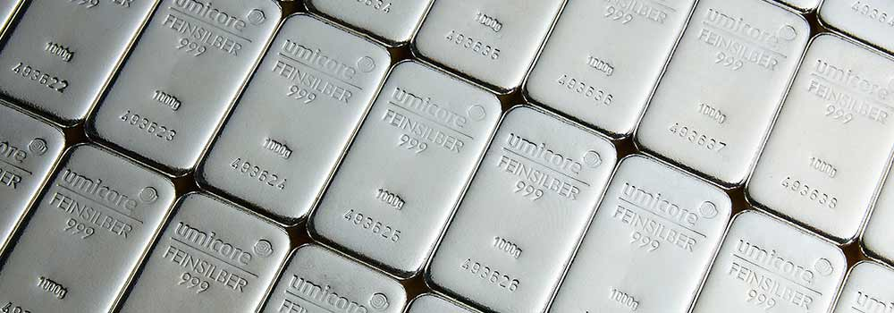 A row of Umicore silver bullion bars from Bleyer
