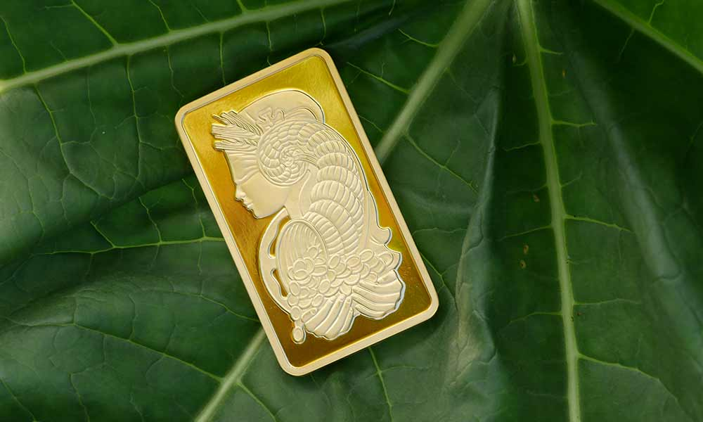 Gold bar with leaf in background