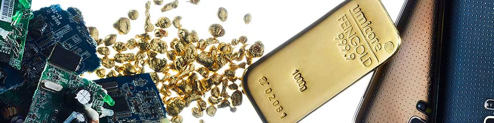 Gold Bar lying between, phones and technology