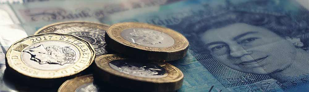UK Pound Coins and Five Pound Bank Note