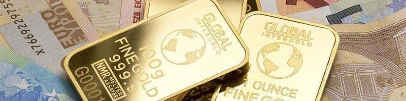 Gold Bullion Bars lying on Euro notes