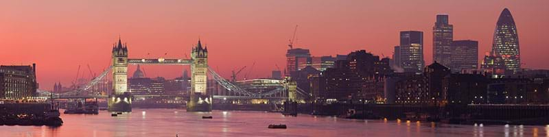 The Themes at sunset with London and Tower Bridge in background