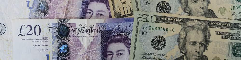 Twenty Pound Note next to a Dollar Bill Note