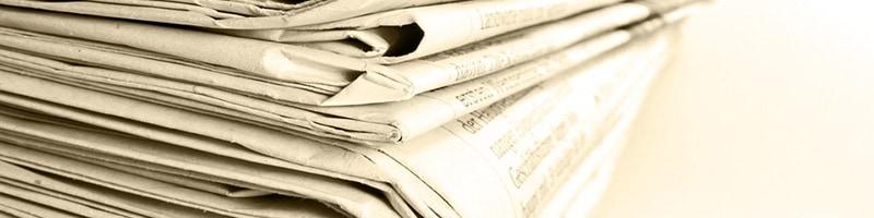 Pile of print newspapers