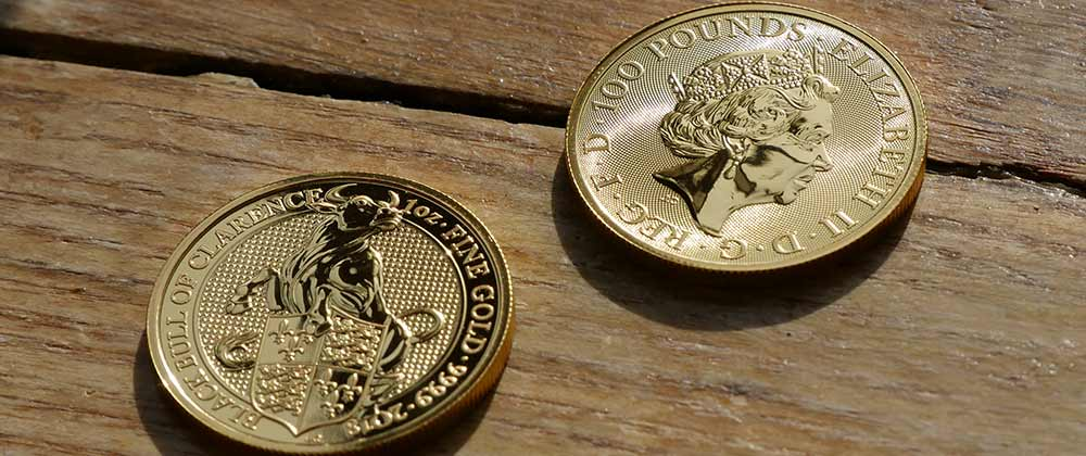 The front and back designs of The Royal Mints UK Queen's Beast Black Bull of Clarence 2018 Gold Coin