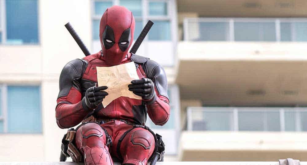 Photo of Deadpool sat on a wall
