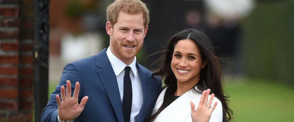 Prince Harry poses with his fiancee Meghan Markle