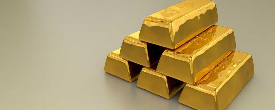 Six gold bullion bars stacked up