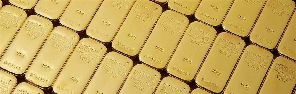 1KG Gold Bullion Umicore Bars layed out in a row