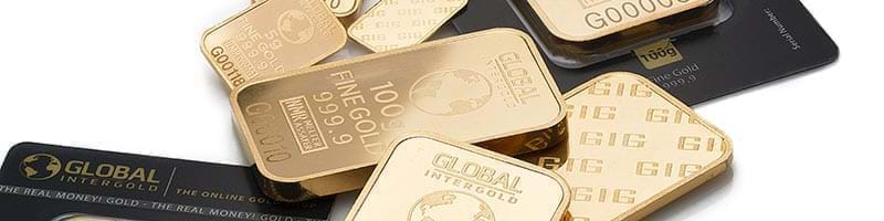 A small pile of 100g Gold Bullion Bars