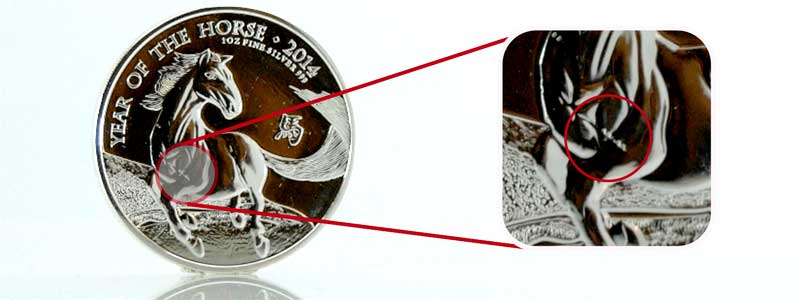 1oz silver Lunar Horse 2014 coin highlighting a scratch on the coin