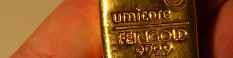 Small Umicore Gold Bullion Bar in someone's hand